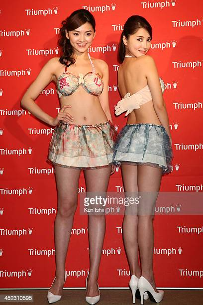 Models pose at launch of 'Omotenashi Japanese Hospitality Compact Bra' for lingerie brand Triumph International Japan at Hama Rikyu Garden Conference...