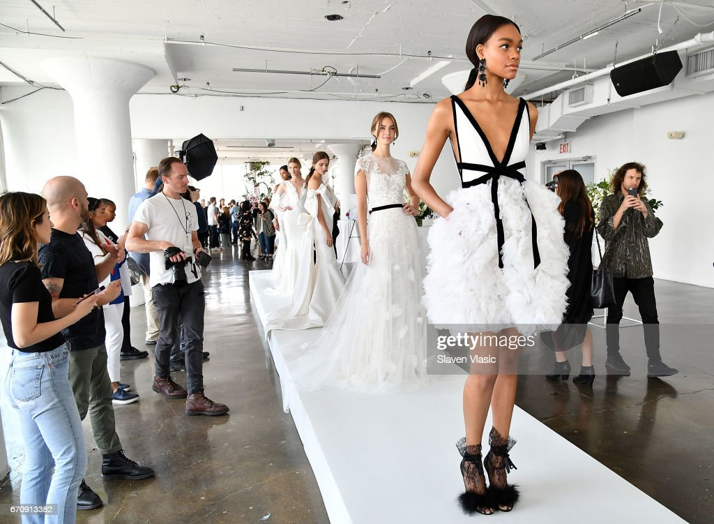 Models pose at Marchesa Bridal Presentation during New York Fashion Week: Bridal April 2017 at Canoe Studios on April 20, 2017 in New York City.