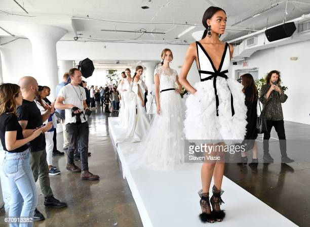 Models pose at Marchesa Bridal Presentation during New York Fashion Week Bridal April 2017 at Canoe Studios on April 20 2017 in New York City