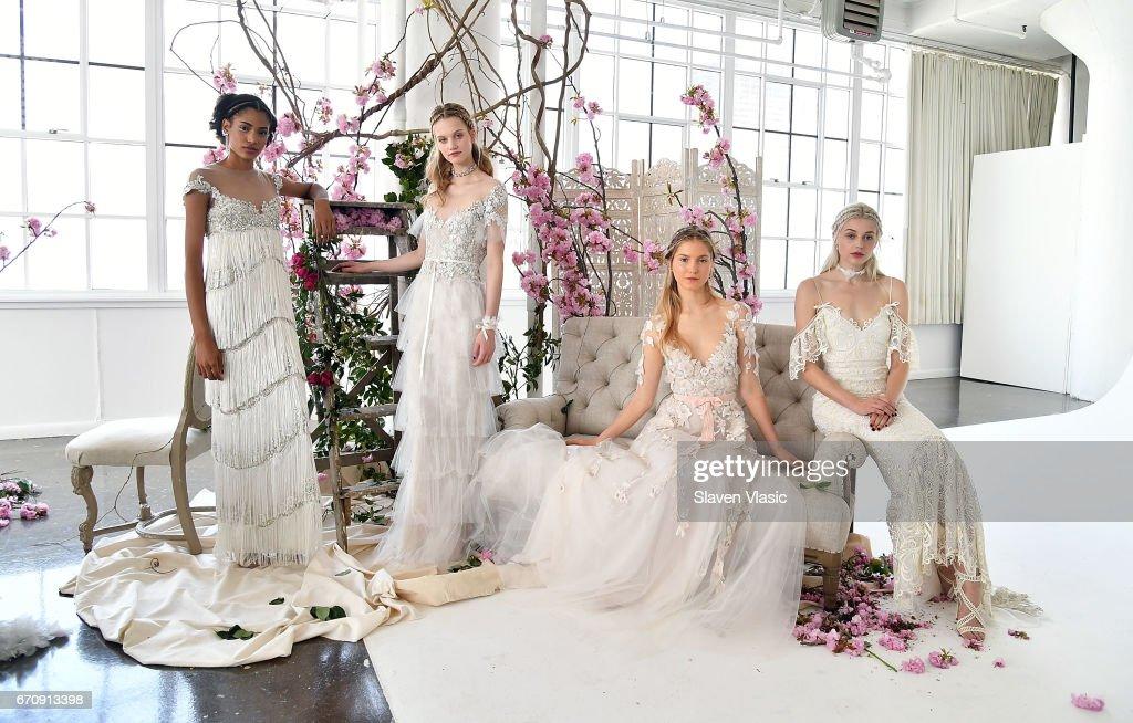 Models pose at Marchesa's Notte Bridal Presentation during New York Fashion Week: Bridal April 2017 at Canoe Studios on April 20, 2017 in New York City.