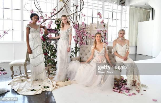 Models pose at Marchesa's Notte Bridal Presentation during New York Fashion Week Bridal April 2017 at Canoe Studios on April 20 2017 in New York City
