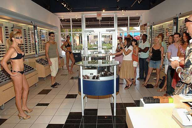 aa1f9fb541a76 Models pose at Sunglass Hut on Lincoln Road during the Sunglass Hut Swim  Shows Miami July