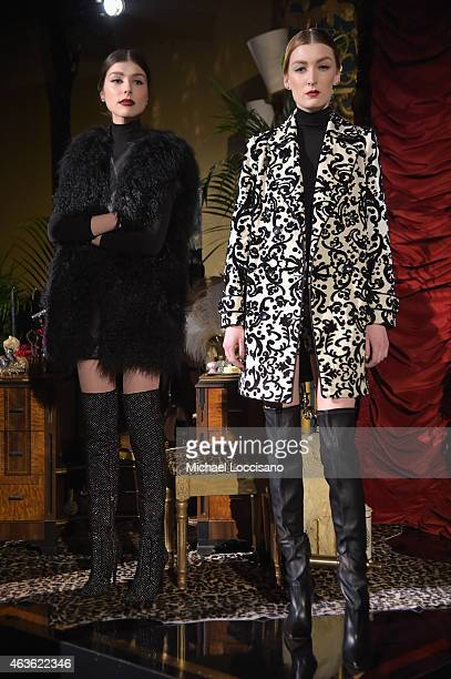Models pose at the alice olivia by Stacey Bendet presentation during MercedesBenz Fashion Week Fall 2015 on February 16 2015 in New York City