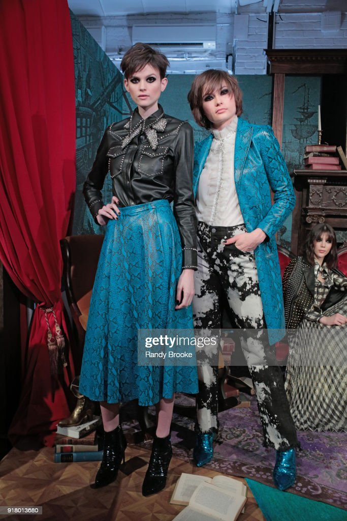 Models pose at the Alice + Olivia By Stacey Bendet Presentation during New York Fashion Week at Industria Studios on February 13, 2018 in New York City.