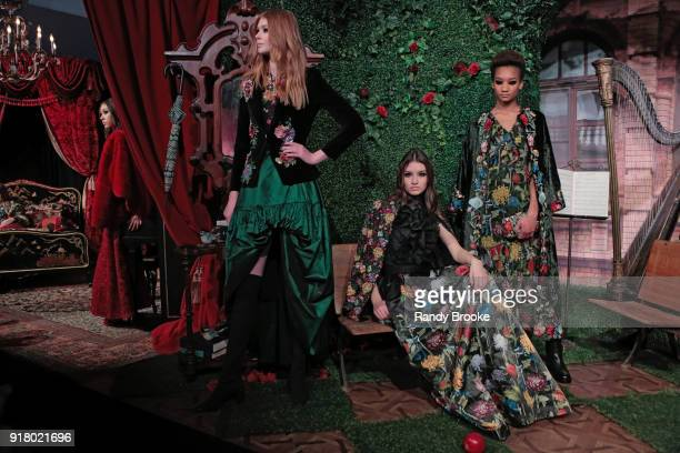 Models pose at the Alice Olivia By Stacey Bendet Presentation during New York Fashion Week at Industria Studios on February 13 2018 in New York City