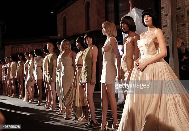 Models pose at the August Getty Atelier SS 2016 'The Thread Of Man' presentation with David LaChapelle at Universal Studios Hollywood on November 11...