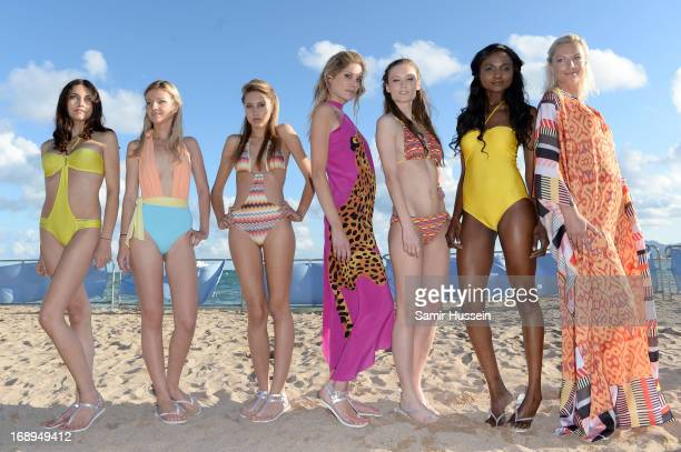 Models pose at the Brazil Bikini Show during the 66th Annual Cannes Film Festival at Goeland Beach on May 17 2013 in Cannes France