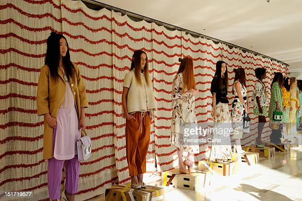 Models pose at the Chris Benz Spring 2013 presentation during MercedesBenz Fashion Week at Avery Fisher Hall Lincoln Center on September 10 2012 in...