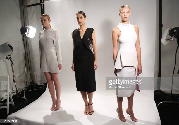 Models pose at the Christophe Esber And Ellery Spring 2013 presentation during Spring 2013 fashion show during Mercedes-Benz Fashion Week on...