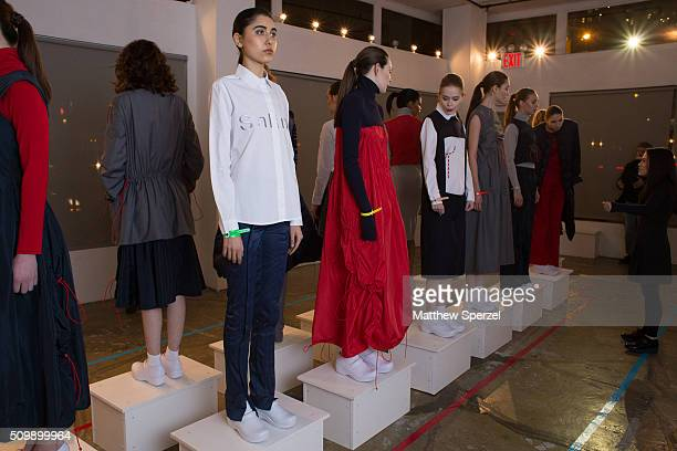 Models pose at the Damnsel 'Garmeoplasty' presentation during Fall 2016 New York Fashion Week on February 12 2016 in New York City