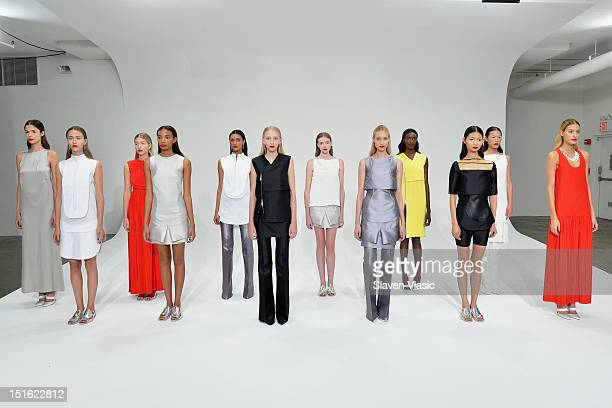 Models pose at the Dean Quinn Spring 2013 presentation during Spring 2013 Mercedes-Benz Fashion Week at Milk Studios on September 8, 2012 in New York...