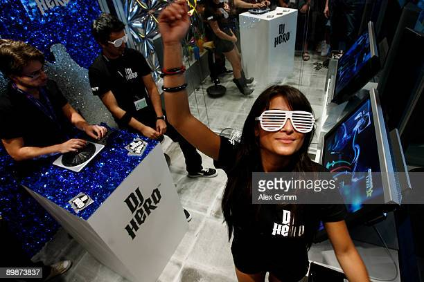 Models pose at the DJ Hero stand of US video game company Activision during the 'gamescom' Europe's biggest trade fair for interactive games and...