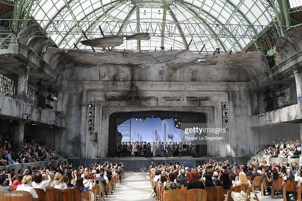 Models pose at the end of the Chanel show as part of Paris Fashion Week Haute-Couture Fall/Winter 2013-2014 at Grand Palais on July 2, 2013 in Paris, France.