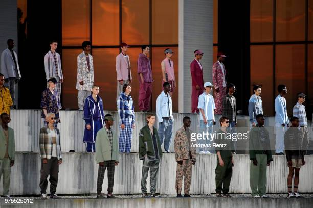 Models pose at the end of the runway at the Ermenegildo Zegna show during Milan Men's Fashion Week Spring/Summer 2019 on June 15 2018 in Milan Italy
