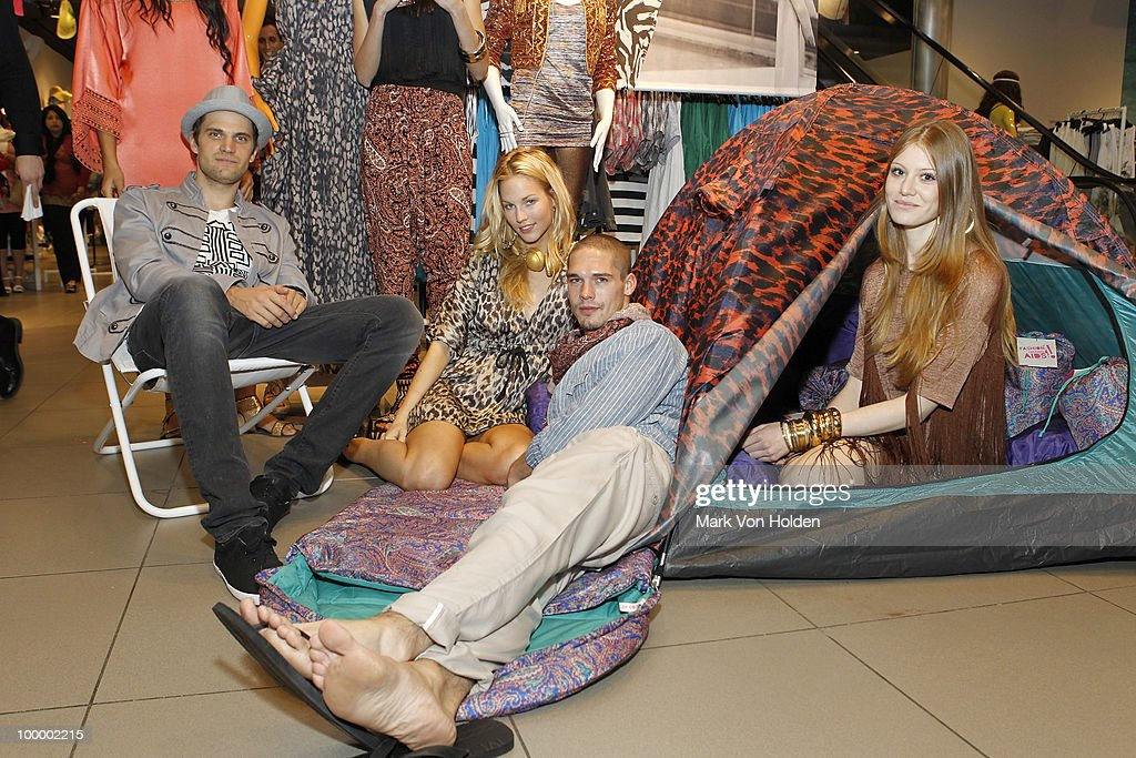 H & M models pose at the H&M's launch of Fashion Against AIDS at H&M Fifth Avenue on May 19, 2010 in New York City.