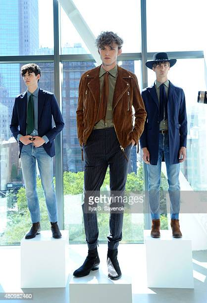 Models pose at the J. Lindeberg presentation during New York Fashion Week: Men's S/S 2016 at Spring Studios on July 16, 2015 in New York City.