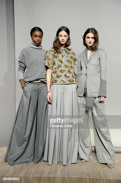 Models pose at the J.Crew presentation during Mercedes-Benz Fashion Week Fall 2015 at The Pavilion at Lincoln Center on February 17, 2015 in New York...