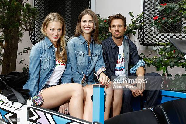 Models pose at the Johnny Pigozzi Limoland Replay Presentation during the 65th Annual Cannes Film Festival on May 19 2012 in Cannes France