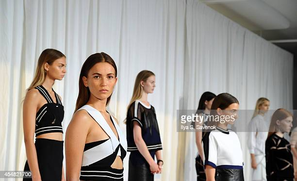 Models pose at the Jonathan Simkhai fashion show during MADE Fashion Week Spring 2015 at Milk Studios on September 6 2014 in New York City