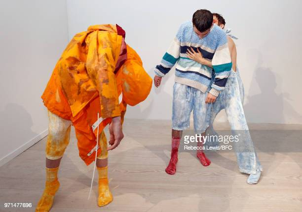 Models pose at the Ka Wa Key DiscoveryLAB during London Fashion Week Men's June 2018 at the BFC Show Space on June 11, 2018 in London, England.