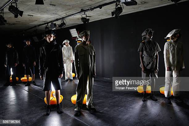 Models pose at the Kiko Kostadinov presentation during The London Collections Men SS17 at BFC Presentation Space on June 13 2016 in London England