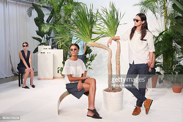 Models pose at the Krewe New Orleans Eyewear presentation during MADE Fashion Week September 2016 at Milk Studios on September 11 2016 in New York...