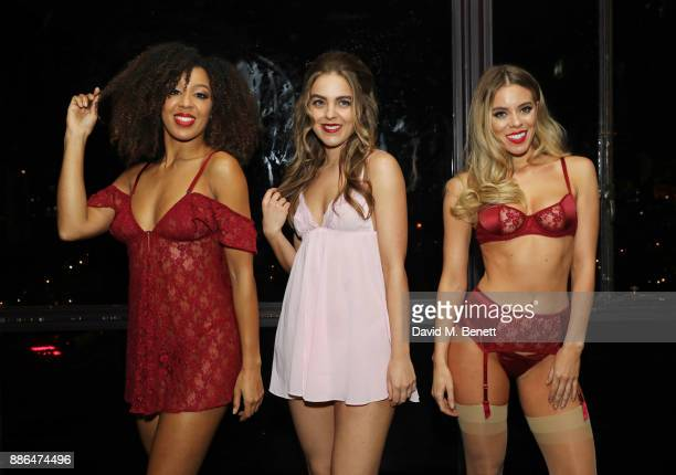 Models pose at the launch of Pamela Anderson's exclusive Coco De Mer collection at Morton's on December 5, 2017 in London, England.