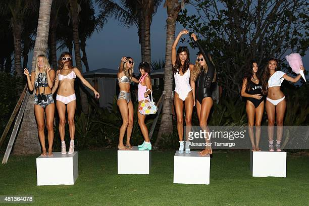 Models pose at the Lolli x Amuse Society Miami Swim Party at Edition Hotel on July 19 2015 in Miami Florida
