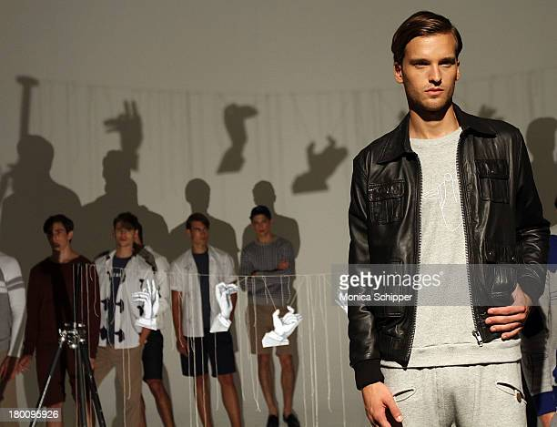 Models pose at the Lucio Castro presentation during MercedesBenz Fashion Week Spring 2014 at Milk Studios on September 8 2013 in New York City
