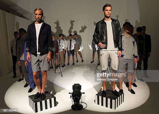 Models pose at the Lucio Castro presentation during MercedesBenz Fashion Week Spring 2014 at Milk Studios on September 8 2013 in New York CityÊ