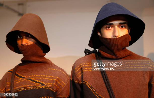 Models pose at the Omar Afridi presentation at the DiscoveryLAB during London Fashion Week Men's January 2019 at the BFC Designer Showrooms on...