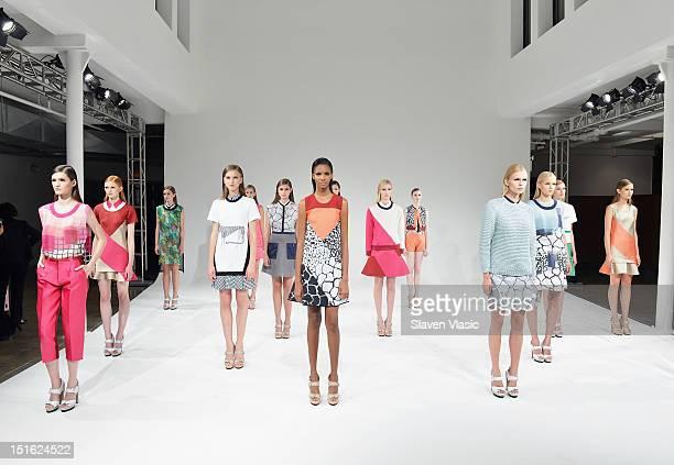 Models pose at the Ostwald Helgason Spring 2013 presentation during Spring 2013 Mercedes-Benz Fashion Week at Milk Studios on September 8, 2012 in...