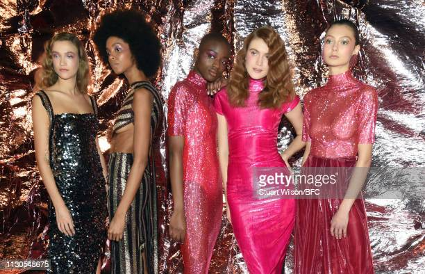 Models pose at the Paula Knorr presentation during London Fashion Week February 2019 at the BFC Show Space on February 18 2019 in London England