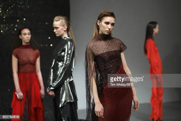 Models pose at the Paula Knorr Presentation during London Fashion Week February 2018 at BFC Show Space on February 19, 2018 in London, England.