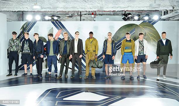 Models pose at the Perry Ellis presentation during New York Fashion Week Men's Spring/Fall 2017 at the Hippodrome Building on July 11 2016 in New...