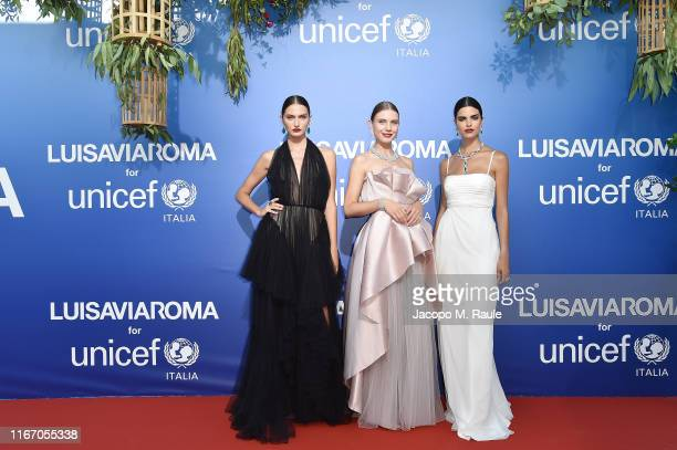 Models pose at the photocall during the Unicef Summer Gala Presented by Luisaviaroma at on August 09, 2019 in Porto Cervo, Italy.