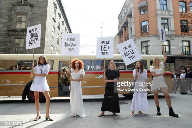 Models arrive in a bus at the runway at the Pia Tjelta Presented by Promenaden Fashion District show during Oslo Runway SS19 at Nedre slottsgate on...