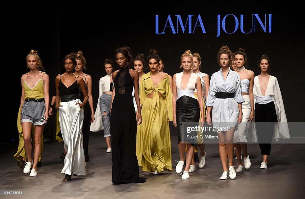 Models pose at the runway during the Lama Jouni show at Fashion Forward Spring/Summer 2017 held at the Dubai Design District on October 22, 2016 in Dubai, United Arab Emirates.