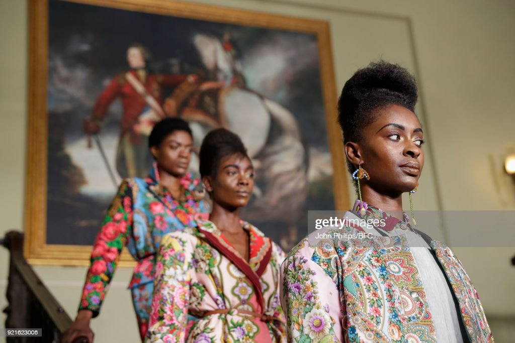 Models pose at the Tata Naka Presentation during London Fashion Week February 2018 on February 20, 2018 in London, England.
