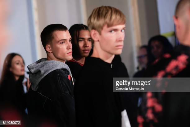 Models pose backsgtage before the REPRESENT fashion show during the NYFW Men's July 2017 Skylight Clarkson Sq on July 13 2017 in New York City
