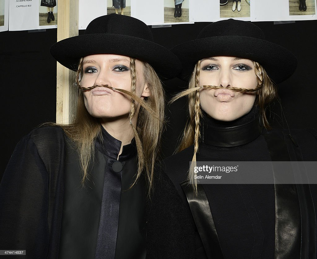 Models pose backstage ahead of Grinko show during Milan Fashion Week Womenswear Autumn/Winter 2014 on February 23, 2014 in Milan, Italy.