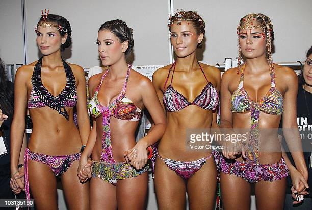 Models pose backstage ahead of the Agua Bendita runway on the first day of Colombiamoda 2010 at Plaza Mayor on July 27 2010 in Medellin Colombia