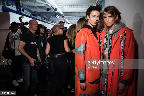 Models pose backstage ahead of the Christopher Raeburn show during the London Fashion Week Men's June 2017 collections on June 11 2017 in London...