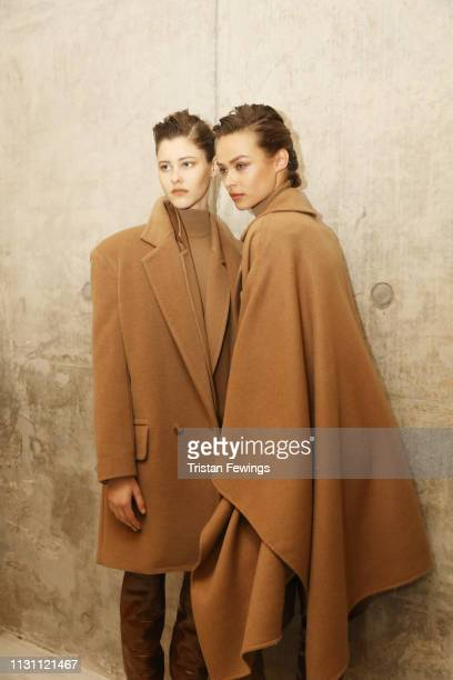 Models pose backstage ahead of the Max Mara show at Milan Fashion Week Autumn/Winter 2019/20 on February 21 2019 in Milan Italy