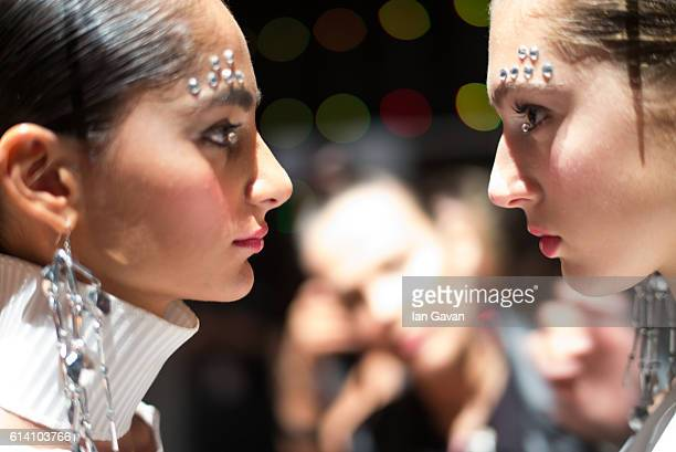 Models pose backstage ahead of the Selma State show during MercedesBenz Fashion Week Istanbul at Zorlu Center on October 12 2016 in Istanbul Turkey