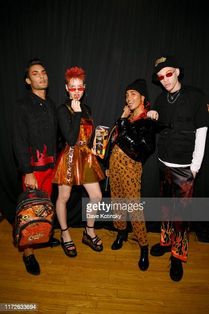 Models pose backstage as Cheetos unveiled faninspired versions of the #CheetosFlaminHaute look at The House Of Flamin' Haute Runway Show Style Bar...