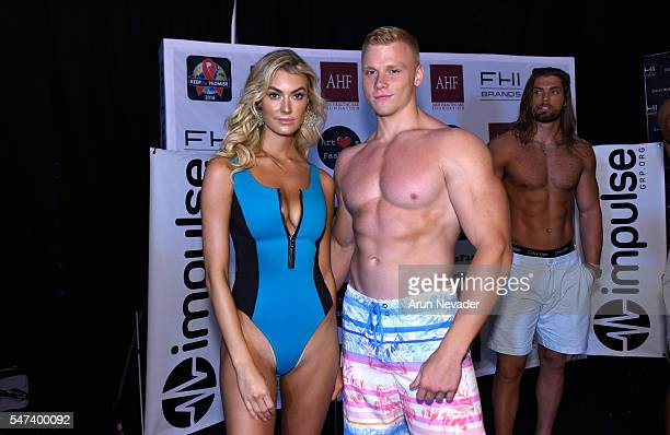 Models pose backstage at Art Hearts Fashion Miami Swim Week Presented by AIDS Healthcare Foundation at Collins Park on July 14 2016 in Miami Beach...