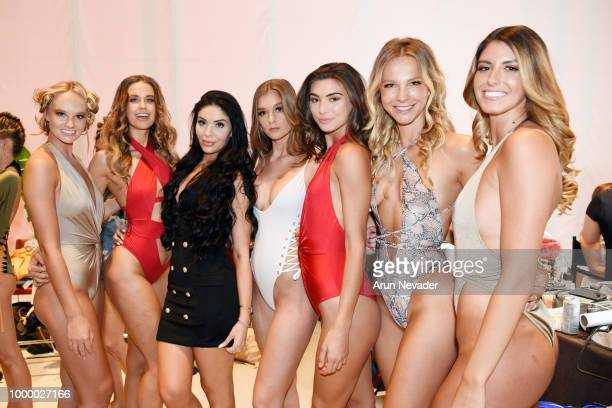 Models pose backstage at Miami Swim Week powered by Art Hearts Fashion Swim/Resort 2018/19 at Faena Forum on July 15 2018 in Miami Beach Florida