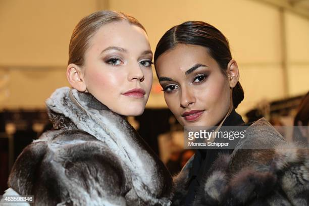 Models pose backstage at the Dennis Basso fashion show during MercedesBenz Fashion Week Fall 2015 at The Theatre at Lincoln Center on February 16...