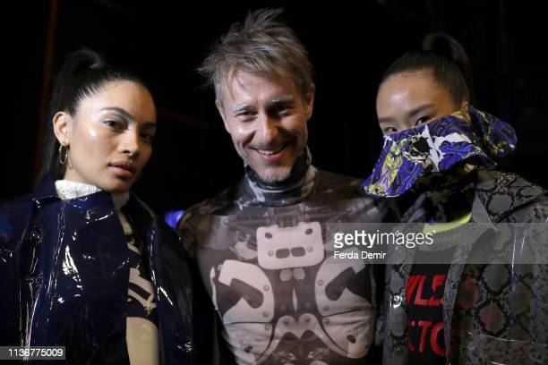 Models pose backstage at the Emre Pakel show during MercedesBenz Istanbul Fashion Week at the Zorlu Performance Hall on March 19 2019 in Istanbul...